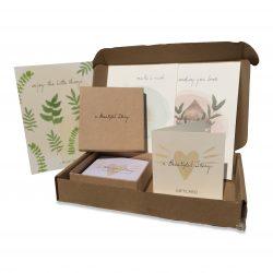 Cadeaubon voor fairtrade sieraden merk A Beautiful Story in doosje inclusief gratis postkaarten met mooie teksten